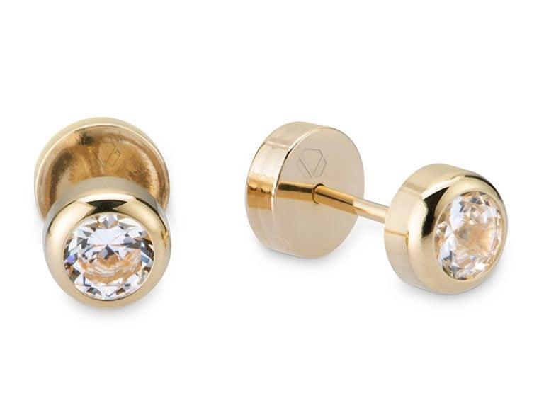 Abridores Tubo  Producto Oro Amarillo 18k y 2 circones brillantes, con cierre tope.