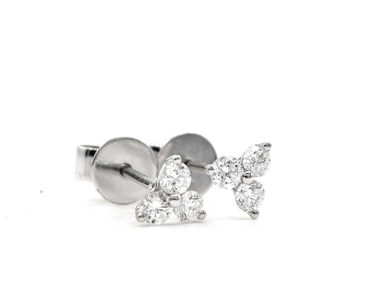 Aros tres petalos oro blanco con diamantes