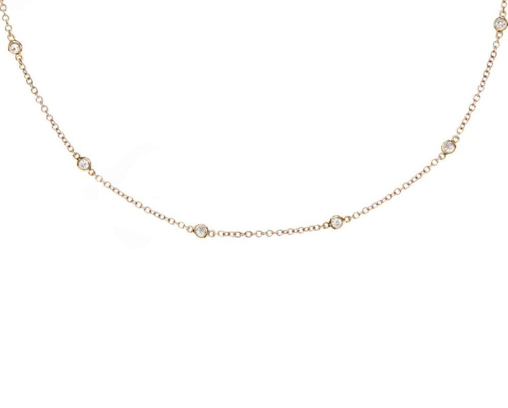 Oro Rosado 18k y 13 Diamantes que suman 51 pt