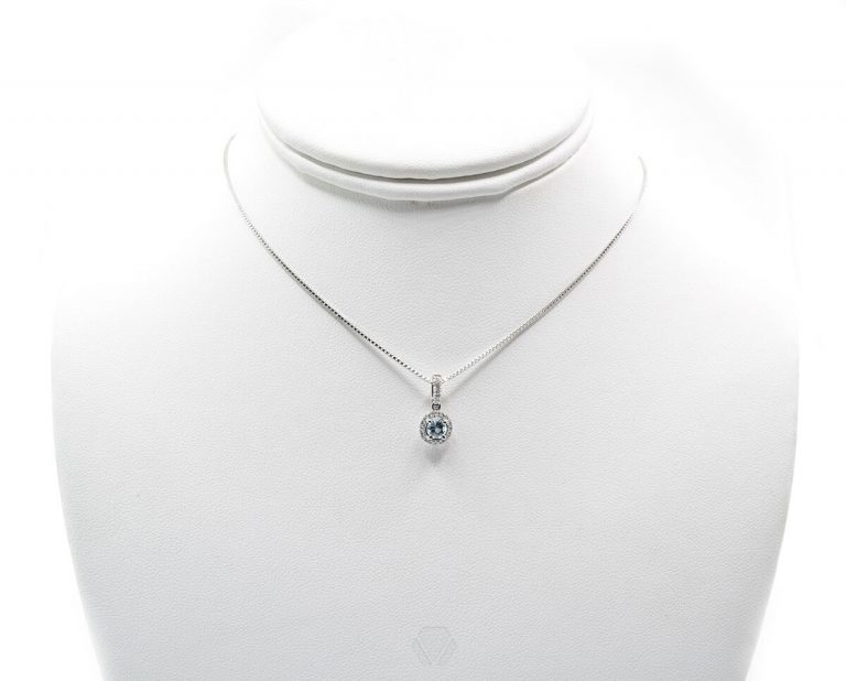 Oro Blanco con 1 Aguamarina brillante 4mm más 23 Diamantes que suman 11 pt