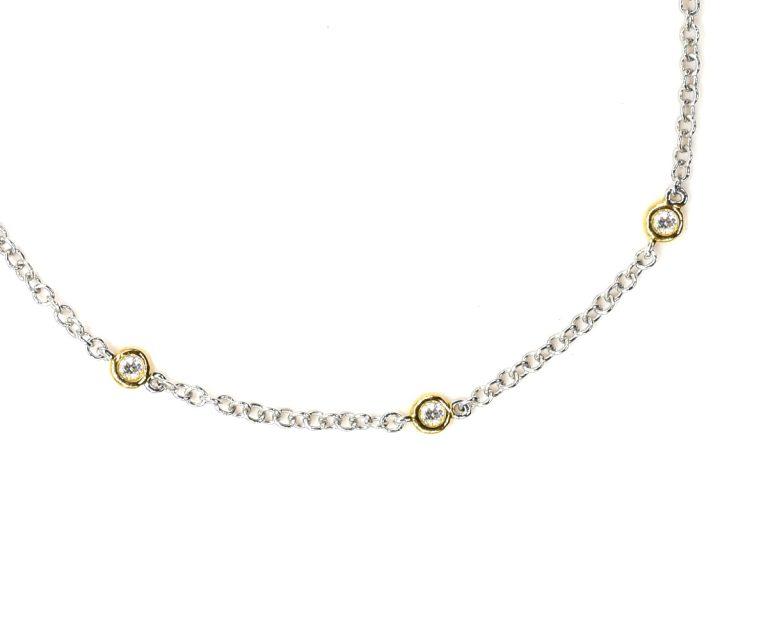 Pulsera Oro 18k Amarillo y Blanco y 10 Diamantes brillante que suman 22 pt. 16 cm.