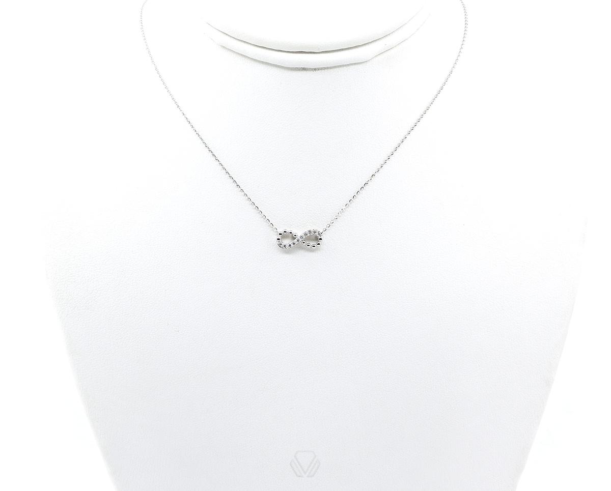 Colgante Infinity Oro Blanco 18k, con Diamante. Incluye cadena.